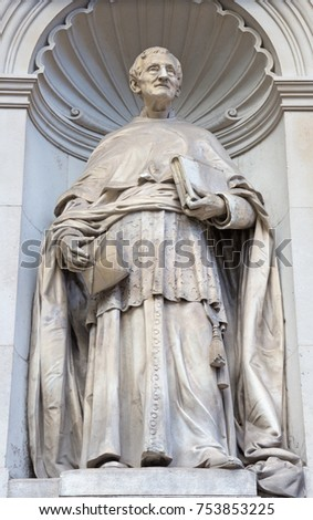 LONDON, GREAT BRITAIN - SEPTEMBER 13, 2017: The statue of cardinal John Henri Newman in fron of Brompton oratory by L. J. Chavalliaud (1858 - 1921).