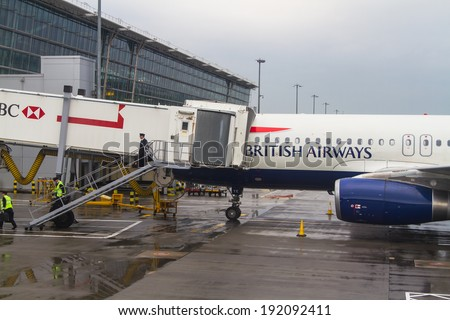 LONDON HEATHROW - APRIL 20: British Airways Airbus A320 parks at gate at Heathrow Airport in London on April 20, 2014. Heathrow had 65.7 million passengers arriving and departing in 2010. - stock photo
