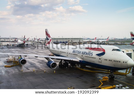 LONDON HEATHROW - APRIL 20: British Airways 747 jumbo jet parks at gate at Heathrow Airport in London on April 20, 2014. Heathrow had 65.7 million passengers arriving and departing in 2010. - stock photo