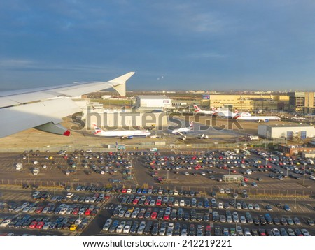 LONDON HEATHROW, UK - CIRCA DECEMBER 2014: Aerial view from a flying plane while landing - stock photo