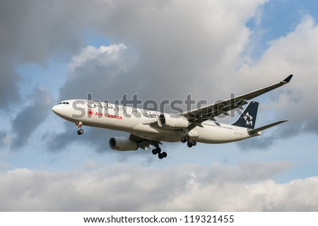 LONDON, HEATHROW, UK - OCTOBER 30: Airbus A321 operated by Air Canada, a member of the Star Alliance global network of airlines that fly routes to London Heathrow Airport, UK - October 30, 2012 - stock photo