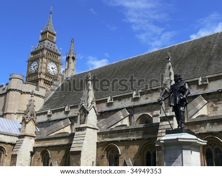 London Houses of Parliament and statue of Oliver Cromwell with Big Ben clock in the background - stock photo