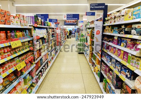 LONDON - JAN 28:  Aisle view of a Tesco supermarket on Jan 28, 2015 in London, UK. Britain's Tesco is the world's third largest supermarket retailer after America's Walmart and France's Carrefour. - stock photo