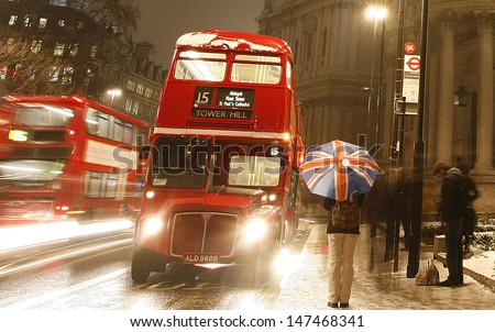 LONDON - JAN 18: Heritage Routemaster Bus operated in London from 1956 to 2005, at night on Jan 18, 2013 in London, UK. The open platform allowed minimal boarding time and optimal security.   - stock photo
