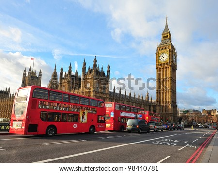 LONDON - JAN 21: London Buses with Big Ben on January 21, 2012 in London, England. The London Bus service is one of the largest urban bus networks in the world with 8,000 buses covering 700 routes. - stock photo
