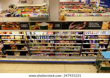 LONDON - JAN 28: Shelf aisle view at a Tesco store on Jan 28, 2015 in London, UK. Britain's Tesco is the world's third largest supermarket retail chain after America's Walmart and France's Carrefour. - stock photo