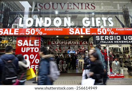 LONDON - JAN 19: The famous Oxford Street pack with crowds of tourists and locals doing their big January shopping on January 19, 2015 in London, UK.   - stock photo