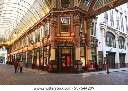London - Jan 17, 2009: unnamed people walk  through the Victorian arcade of the Leadenhall Market, built in the 19th century and frequently featured in films and television.