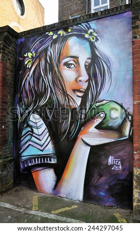 LONDON - JANUARY 11. A painting by Italian artist Alice Pasquini on January 11, 2015, at Phipp Street, Shoreditch in the Borough of Tower Hamlets, an area renown for its street art in east London. - stock photo