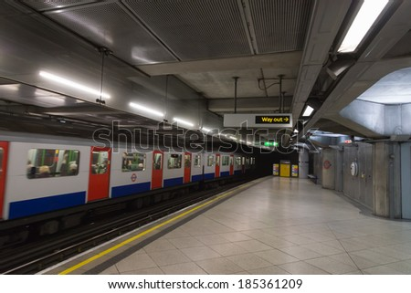 LONDON- JANUARY 01: An interior view of the Underground Tube System in London, England on January 01, 2013. London's system is the oldest underground railway in the world, dating back to 1863. - stock photo