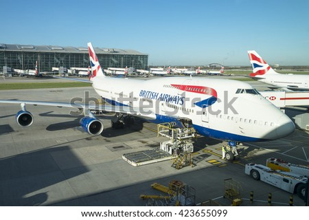 LONDON - JANUARY 28, 2016: British Airways passenger planes stand ready at their gates at Heathrow, which, as the busiest airport in Europe faces chronic capacity issues. - stock photo