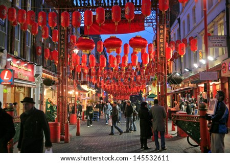 LONDON - JANUARY 20: China Town is decorated by Chinese lanterns during Chinese New Year in London, UK on January 20, 2009. London ChinaTown was established in 1880th of Chinese sailors and traders - stock photo