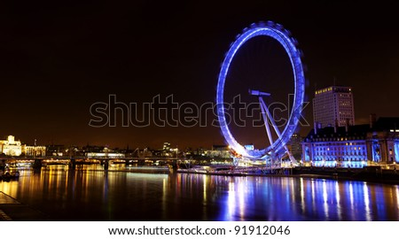 LONDON - JANUARY 1: Night view of The London Eye on January 1, 2012 in London, England. At a height of 135m, it is the tallest Ferris wheel in Europe. - stock photo