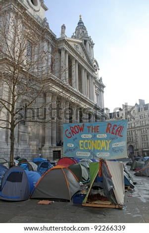 LONDON - JANUARY 5: Occupy London protest and camp at St. Pauls Cathedral in London, England on January 5, 2012 - stock photo