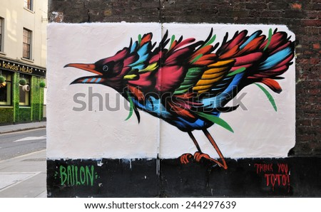 LONDON - JANUARY 11. Painted bird by Brazilian artist Mateus Bailon on January 11, 2015, at corner of Phipp Street and Strutton Street, Shoreditch, an area renown for its street art in east London. - stock photo