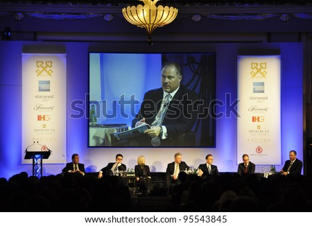 LONDON - JANUARY 30: Speakers on the stage during the 59th UICH les Clefs d'Or International Congress at the Sheraton Park Lane on January 30, 2012 in London, England. - stock photo