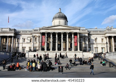 LONDON - JANUARY 21: Tourists crowd on footsteps of famous National Gallery on January 21, 2009 in London. Over 2300 famous masterpieces can be seen for free in the gallery. - stock photo