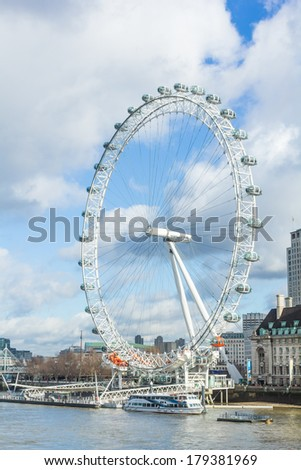 LONDON - January 21,2014: View of The London Eye on August 21, 2014 in London, England. A famous tourist attraction over river Thames in the capital city London.