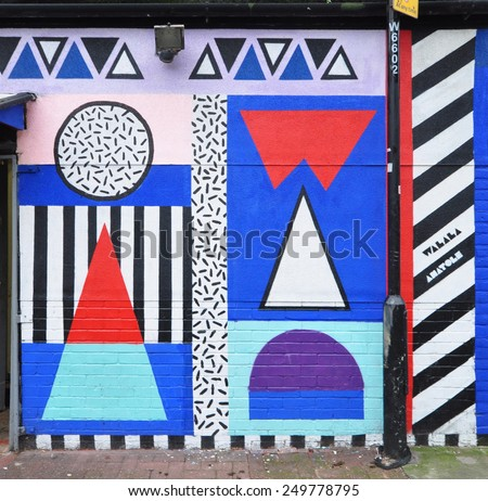 LONDON - JANUARY 11. Wall panting by Walala Anatole on January 11, 2015, at Whitby Street, Shoreditch in the Borough of Tower Hamlets, an area renown for its street art in east London, UK. - stock photo