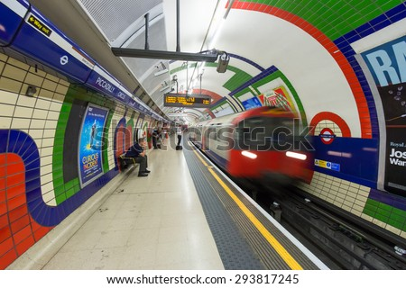 LONDON - JUL 2, 2015: A train arrives at the Piccadilly Circus underground station. London Underground is the 11th busiest metro system worldwide with 1.1 billion annual rides. - stock photo