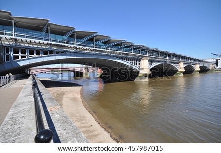LONDON - JULY 19, 2016. Blackfriars Railway Bridge built in 1886 now has platforms over the River Thames with solar roof panels supplying energy to the station below, located in central London, UK. - stock photo