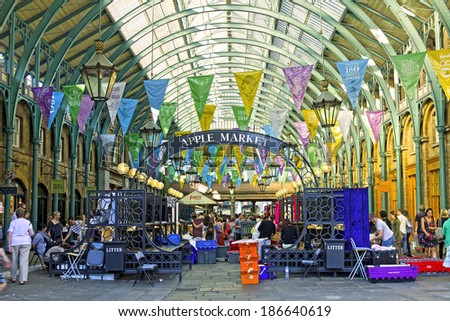 LONDON, JULY 31, 2010: Covent Garden Market. One of the main London attractions, Covent Garden was for many years the main fruit and vegetables market in London - stock photo