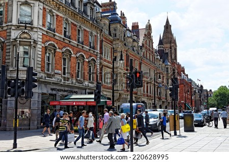 LONDON - JULY 1, 2014: Duke street in central London. It is best known as the setting for the TV series The Duchess of Duke Street and as the headquarters of the Artists' Rifles.  - stock photo