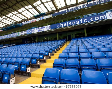 LONDON - JULY 24: Empty seats on a non-match day at the Chelsea FC Stamford Bridge Stadium on July 24, 2011. The stadium capacity is 41,837 making it the eighth largest ground in the Premier League. - stock photo