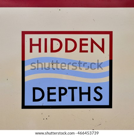 LONDON - JULY 23. 2016.. Hand painted lettering on a narrow boat named Hidden Depths. The company offers canal cruises and party events along the Regent's Canal, located in London, UK.