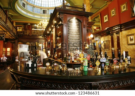 LONDON - JULY 30 : Interior of pub, for drinking and socializing, focal point of community, on July 30, 2012, London, UK. Pub business, now about 53,500 pubs in the UK, has been declining every year - stock photo