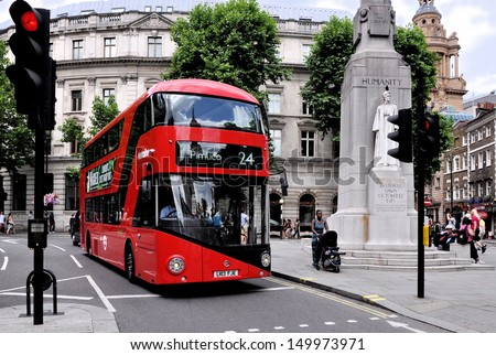 LONDON - JULY 26. London's new Routemaster diesel-electric hybrid double deck bus with three doorways and two staircases accommodates 80 passengers; July 26, 2013, in St Martin's Place, London, UK.  - stock photo