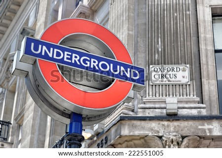 LONDON - JULY 1, 2014: London underground sign at Oxford Circus Station, with the focus on the Underground sign. - stock photo