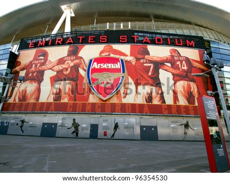 LONDON - JULY 24. One of the 8 murals installed on the exterior of Arsenal FC Emirates Stadium, the Arsenalisation project depicting four Arsenal legends linking arms on Jul 24, 2011, London, England. - stock photo
