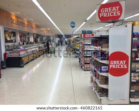 LONDON - JULY 30: Shoppers in the aisles of Sainsbury's Supermarket at the O2 Centre Finchley Road on July 30, 2016 in London, UK.