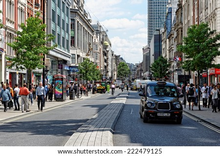 LONDON - JULY 1, 2014. Shoppers on Oxford street, the biggest shopping street in Europe, visited by millions of tourists. - stock photo