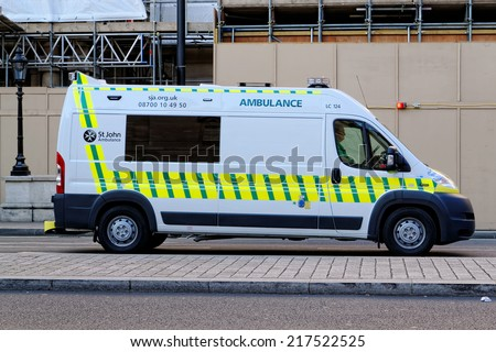 LONDON - JULY 1: St. John Ambulance on July 1 2014 in London, UK. Medical first aid and the provision of ambulance services was founded in 1877 in the United Kingdom. - stock photo