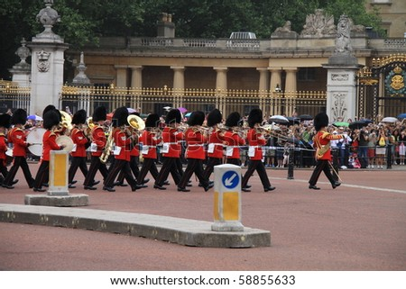 LONDON - JULY 26: Summer uniforms debut on July 26, 2010, for the changing of the guards ceremony at Buckingham Palace, in London. - stock photo