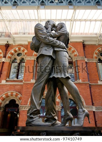 LONDON - JULY 24. The Embracing Couple by Paul Day at 'the Meeting Place' greets passengers in preparation for London Olympic 2012 at St Pancras International Railway Station. July 24, 2011. - stock photo