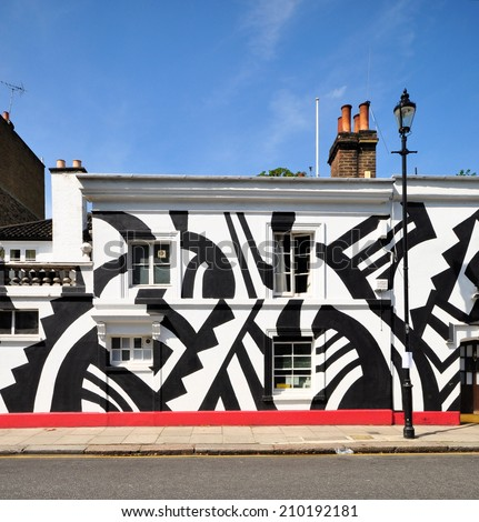 LONDON - JULY 1. The facade of Chelsea Arts Club on July 1, 2014; a temporary tribute to the World War One British and USA artists who painted ships in Dazzle Camouflage, located in Chelsea, London.
