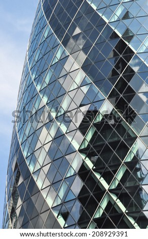 LONDON - JULY 26. The multi-faceted building at 30 St Mary Axe, known informally as the Gherkin, on July 26, 2014, designed by Foster and Partners and located in the financial district of London, UK. - stock photo