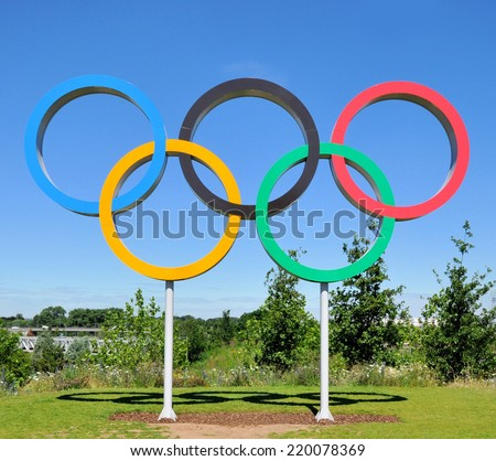 LONDON - JULY 3. The Olympic Games symbol in the new Queen Elizabeth Olympic Park, on July 3, 2014, a legacy from the games in the large landscaped public recreation area at Stratford, London, UK. - stock photo