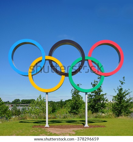 LONDON - JULY 3, 2014. The Olympic Games symbol in the Queen Elizabeth Olympic Park; a legacy of the games at Stratford, east London, UK. - stock photo
