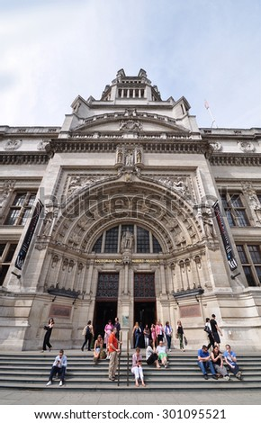 LONDON - JULY 18, 2015. The Victoria & Albert Museum front entrance. The 1852 building houses the world's largest collection of decorative arts and design, located at South Kensington, London, UK. - stock photo