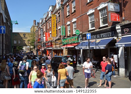 LONDON - JULY 21, 2013: Tourists in Brick Lane on a busy summer Saturday afternoon on July 21, 2013 in London. - stock photo