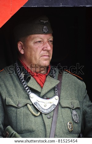 LONDON - JULY 21 - Unidentified member of the public poses as German WW2 soldiertake part in largest reenactment of WW2 in the world at War and Peace, 21st July 2011 in London, England