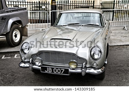 """LONDON - JUN 23 : Aston Martin (from the James Bond movie) displayed at the """"city of London festival"""", pictured on June 23rd, 2013, in London, UK. It is an art festival that takes place in the city. - stock photo"""