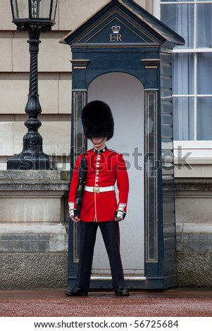 LONDON - JUN 11: Sentry of the Grenadier Guards posted outside of Buckingham Palace on June 11, 2010 in London, UK.