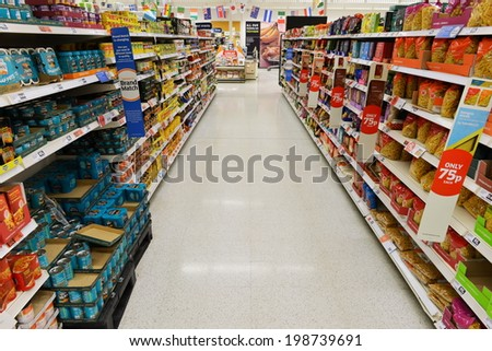 LONDON - JUNE 14: A general view of an empty aisle at a Sainsbury's supermarket on June 14, 2014 in London, UK. Sainsbury's is the UK's second largest supermarket with a revenue of �£23 bln in 2013. - stock photo