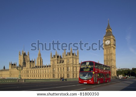 LONDON - JUNE 1: A London Bus near Big Ben on June 1, 2011 in London. The London Bus service is one of the largest urban bus networks in the world with 8,000 buses covering 700 routes. - stock photo