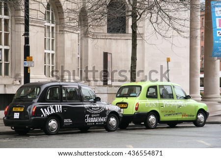 LONDON - JUNE 10,2014 : A London Taxi in London cabs undergo a strict annual mechanical test before they are allowed for hire. - stock photo